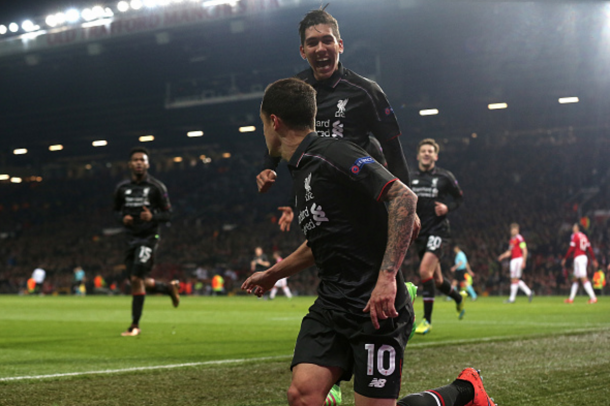 Firmino celebrates Coutinho's goal in the Reds' second-leg draw with United recently. (Picture: Getty Images)