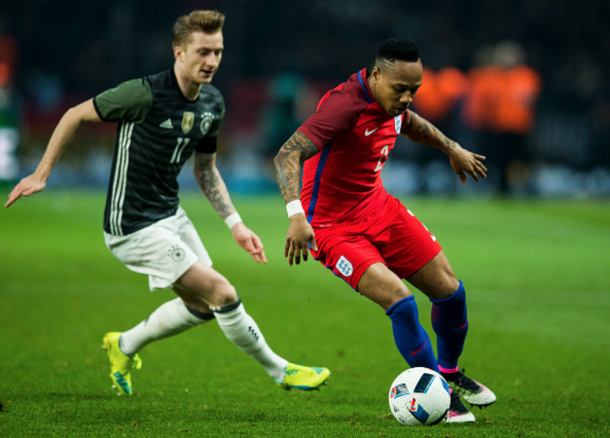 Nathaniel Clyne attempts to evade Marco Reus, who he will face at club level next month. (Picture: Getty Images)