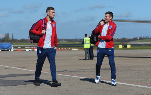 Milner jokes with clubmate Henderson before flying to Berlin earlier in the week. (Picture: Getty Images)