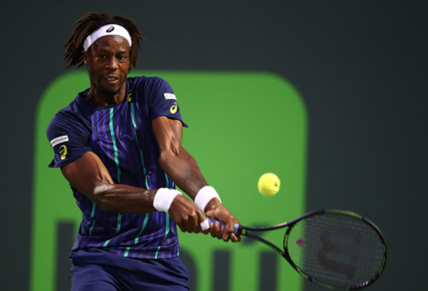 Gael Monfils of France plays a backhand against Grigor Dimitrov of Bulgaria in their fourth round match during the Miami Open Presented by Itau at Crandon Park Tennis Center on March 29, 2016 in Key Biscayne, Florida. (Photo by Clive Brunskill/Getty Images)