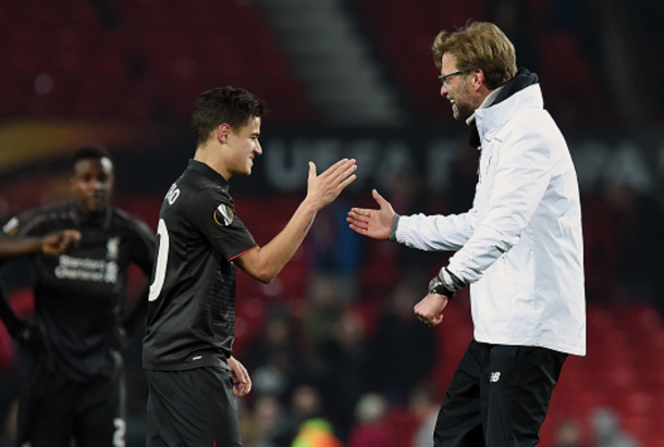 A delighted Klopp with Coutinho after his stunning solo goal away at United. (Picture: Getty Images)