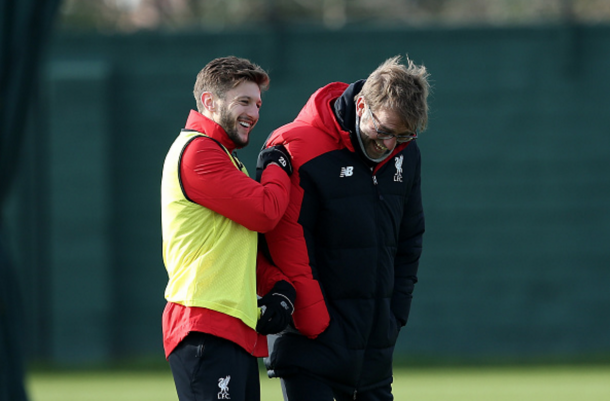 Lallana shares a joke with Klopp in training. (Picture: Getty Images)