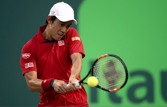 Kei Nishikori returns a shot during his semifinal match.  Photo Courtesy: Getty Images Sport | Matthew Stockman