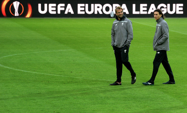 Klopp and his assistant, Zeljko Buvac, walking on familiar turf in an open training session. (Picture: Getty Images)