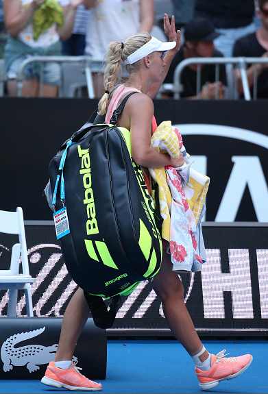Caroline Wozniacki exits the court after her first round loss at the Australian Open.  Photo Courtesy: Getty Images Sport | Michael Dodge