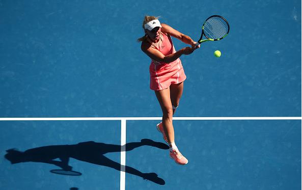 Wozniacki plays a backhand at the Australian Open.  Photo Courtesy: Getty Images Sport | Mark Kolbe