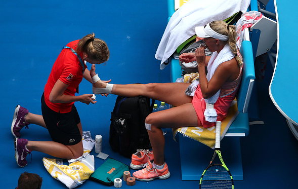 Wozniacki receives treatment at the Australian Open.  Photo Courtesy: Getty Images Sport | Mark Kolbe