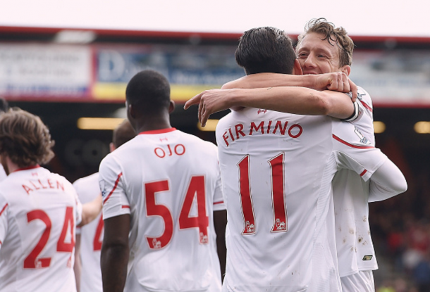 Lucas Leiva and Firmino celebrate Liverpool's opening goal. (Picture: Getty Images)