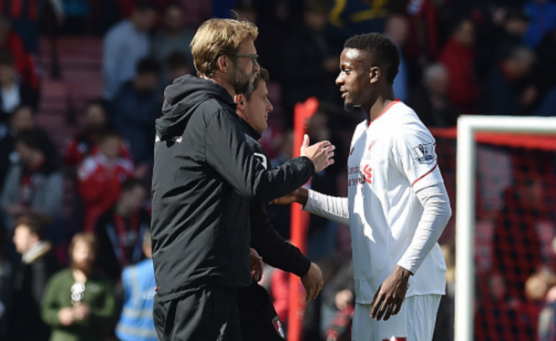 Origi and Klopp after the full-time whistle at Bournemouth on Sunday. (Picture: Getty Images)