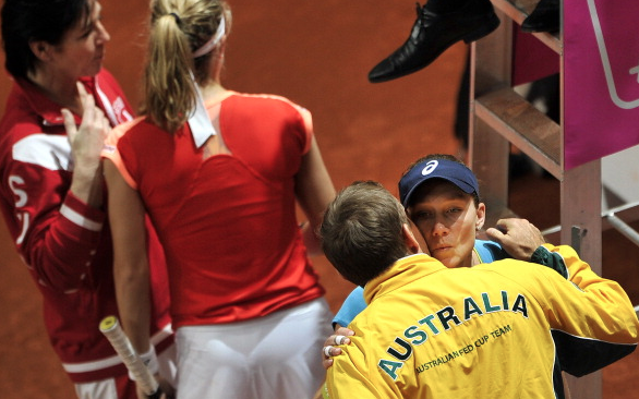 Stosur and Taylor embrace at the 2012 Fed Cup Event.  Photo Courtesy: AFP | Fabrice Coffrini