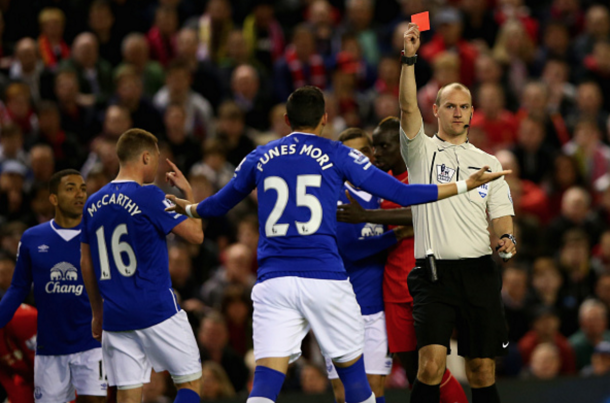 Funes Mori sees red for a horrendous challenge on Origi, which forced the striker off. (Picture: Getty Images)