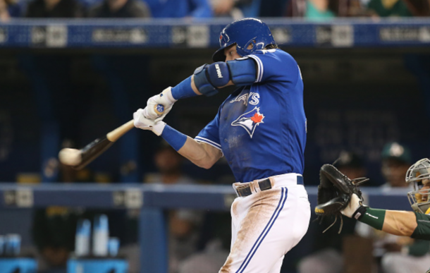 Josh Donaldson #20 of the Toronto Blue Jays hits a single in the first inning during MLB game action against the Oakland Athletics on April 23, 2016 at Rogers Centre in Toronto, Ontario, Canada. (Photo by Tom Szczerbowski/Getty Images)