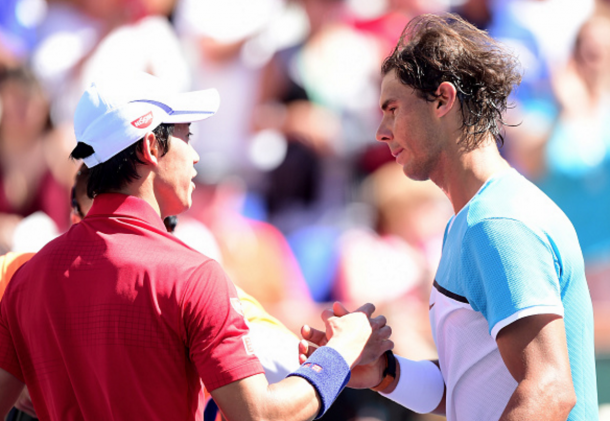 Rafael Nadal of Spain shakes hands with Kei Nishikori of Japan after beating him in straight sets during day twelve of the 2016 BNP Paribas Open at Indian Wells Tennis Garden on March 18, 2016 in Indian Wells, California. (Photo by Harry How/Getty Images)
