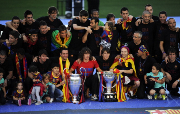 FC Barcelona players pose with the La Liga Tropy and the UEFA Champions League trophy during the celebrations after winning the UEFA Champions League Final against Manchester United at Camp Nou Stadium on May 29, 2011 in Barcelona, Spain. (Photo by David Ramos/Getty Images)