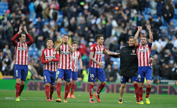 Diego Godin, Matias Kranevitter, Jose Maria Gimenez, Fernando Torres and Gabi Fernandez of Club Atletico de Madrid celebrate after they beat Real 1-0 in the La Liga match between Real Madrid CF and Club Atletico de Madrid at Estadio Santiago Bernabeu on February 27, 2016 in Madrid, Spain. (Photo by Denis Doyle/Getty Images)