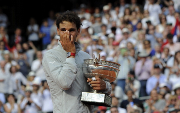 Spain's Rafael Nadal wipes a tear as he holds the Musketeers trophy after winning the French tennis Open men's final match against Serbia's Novak Djokovic at the Roland Garros stadium in Paris on June 8, 2014. AFP PHOTO / DOMINIQUE FAGET (Photo credit should read DOMINIQUE FAGET/AFP/Getty Images)