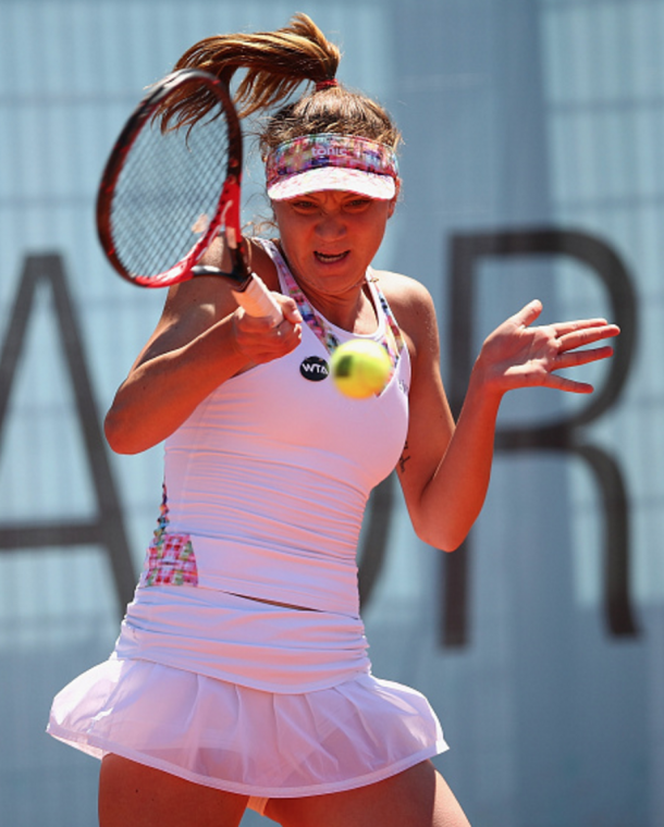 Patricia Maria Tig of Romania plays a forehand against Maria Sakkari of Greece in their second round qualifying match during day one of the Mutua Madrid Open tennis tournament at the Caja Magica on April 30, 2016 in Madrid, Spain. . (Photo by Clive Brunskill/Getty Images)