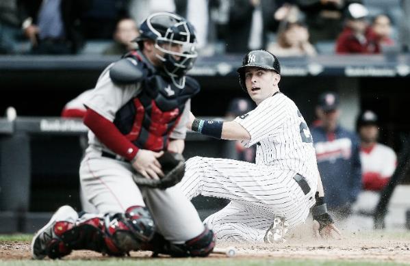 New York's Dustin Ackley slides home in Saturday's 8-2 win. | AP
