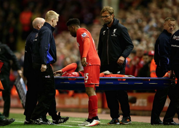 Origi is stretchered off in the Merseyside Derby last month after a nasty-looking injury. (Picture: Getty Images)