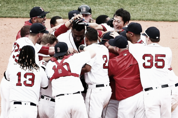 Boston mobs David Ortiz at second base following his game-winner. | Getty