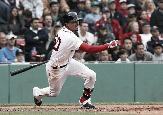 Mookie Betts drives in the go-ahead run in the seventh inning for the Red Sox. | AP