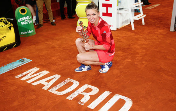 Simona Halep of Romania celebrates with the winners trophy after her win over Dominika Cibulkova of Slovakia in the final during day eight of the Mutua Madrid Open tennis tournament at the Caja Magica on May 07, 2016 in Madrid, Spain. (Photo by Julian Finney/Getty Images)