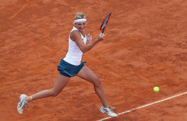 Timea Bacsinszky of Switzerland in action against Garbine Muguruza of Spain during day six of the The Internazionali BNL d'Italia 2016 on May 13, 2016 in Rome, Italy. (Photo by Matthew Lewis/Getty Images)
