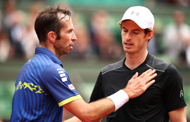 Andy Murray of Great Britain talks with Radek Stepanek of the Czech Republic following the Men's Singles first round match on day three of the 2016 French Open at Roland Garros on May 24, 2016 in Paris, France. (Photo by Clive Brunskill/Getty Images)