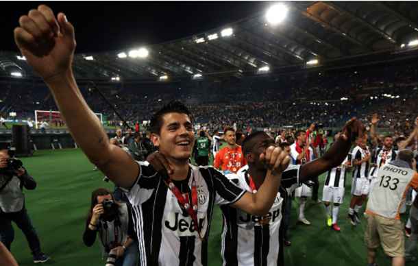 Alvaro Morata of Juventus FC celebrates with trophy after the Tim Cup Final during the TIM Cup match between AC Milan and Juventus FC at Stadio Olimpico on May 21, 2016 in Rome, Italy. (Photo by Gabriele Maltinti/Getty Images)