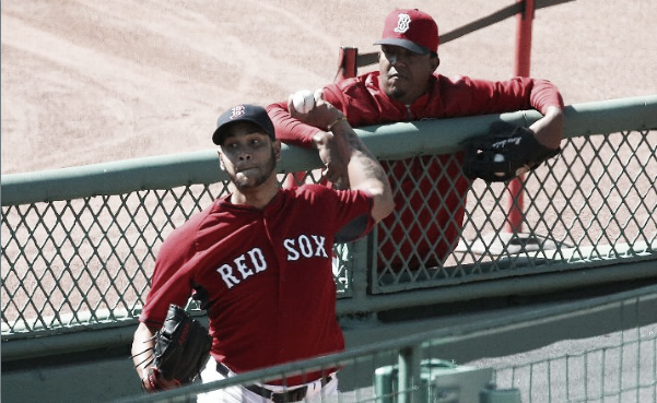 Eduardo Rodriguez throws a bullpen session with Hall of Famer Pedro Martinez looking on. | Getty