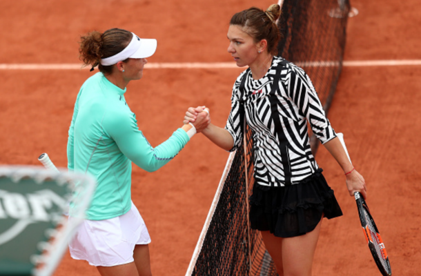 Samantha Stosur of Australia shakes hands with Simona Halep of Romania following her victory during the Ladies Singles fourth round match on day ten of the 2016 French Open at Roland Garros on May 31, 2016 in Paris, France. (Photo by Julian Finney/Getty Images)