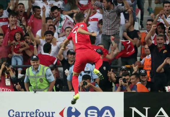 Turkey's Oguzhan Ozyakup celebrates scoring against the Netherlands (source: goal.com)