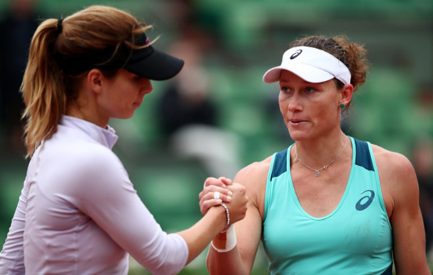 Samantha Stosur of Australia shakes hands with Tsvetana Pironkova of Bulgaria following her victory during the Ladies Singles quarter final match on day eleven of the 2016 French Open at Roland Garros on June 1, 2016 in Paris, France. (Photo by Clive Brunskill/Getty Images)