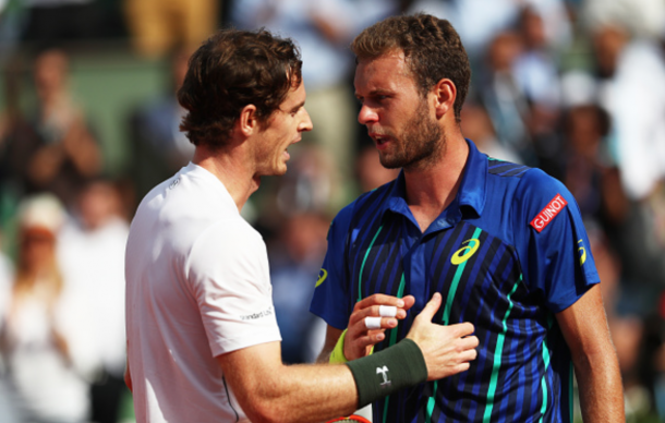 Andy Murray of Great Britain consoles the defeated Mathias Bourgue of France at the net following the Men's Singles second round match on day four of the 2016 French Open at Roland Garros on May 25, 2016 in Paris, France. (Photo by Julian Finney/Getty Images)