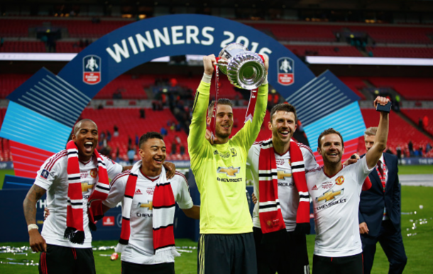 shley Young, Jesse Lingard, David De Gea, Michael Carrick and Juan Mata of Manchester United celebrate with the trophy after The Emirates FA Cup Final match between Manchester United and Crystal Palace at Wembley Stadium on May 21, 2016 in London, England. (Photo by Christopher Lee - The FA/The FA via Getty Images)