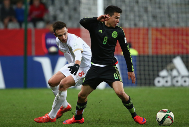 Hirving Lozano of Mexico is challenged by Nemanja Maksimovic of Serbia during the FIFA U-20 World Cup New Zealand 2015 Group D match between Serbia and Mexico at Otago Stadium on June 6, 2015 in Dunedin, New Zealand. (Photo by Robert Cianflone - FIFA/FIFA via Getty Images)