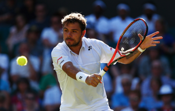 Stanislas Wawrinka of Switzerland plays a backhand in his Gentlemen's Singles first round match against Joao Sousa of Portugal during day one of the Wimbledon Lawn Tennis Championships at the All England Lawn Tennis and Croquet Club on June 29, 2015 in London, England. (Photo by Julian Finney/Getty Images)