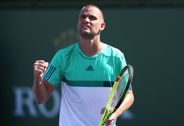 Mikhail Youzhny of Russia celebrates winning a game in his match against Aljaz Bedene of Great Britain during day five of the BNP Paribas Open at Indian Wells Tennis Garden on March 11, 2016 in Indian Wells, California. (Photo by Julian Finney/Getty Images)
