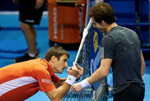 Tommy Robredo of Spain reacts to Andy Murray of Great Britain in the final at the end of the match on day seven of the ATP 500 World Tour Valencia Open tennis tournament at the Ciudad de las Artes y las Ciencias on October 26, 2014 in Valencia, Spain. (Photo by Manuel Queimadelos Alonso/Getty Images)