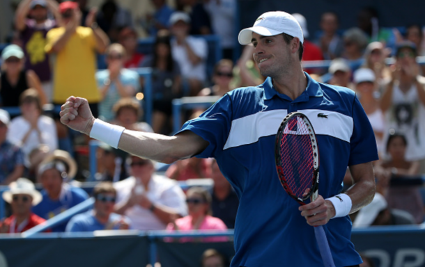 John Isner of the United States reacts against Kei Nishikori of Japan in the men's singles final during the Citi Open at Rock Creek Park Tennis Center on August 9, 2015 in Washington, DC. (Photo by Patrick Smith/Getty Images)