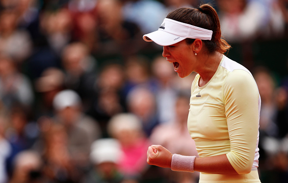 Muguruza celebrates a point victory in the French Open Championship match against Serena Williams