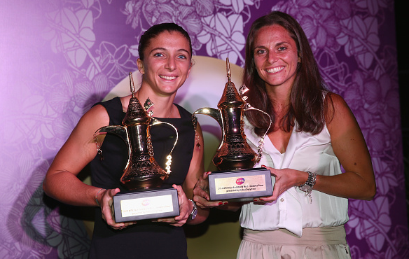 Sara Errani and Roberta Vinci with the trophy for year-end world number ones in doubles in Singapore 2014. Photo:Getty/Clive Brunskill