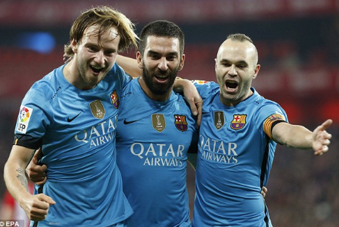 Turan celebrates with Andres Iniesta and Ivan Rakitic who play for Spain and Croatia respectively | Photo: EPA