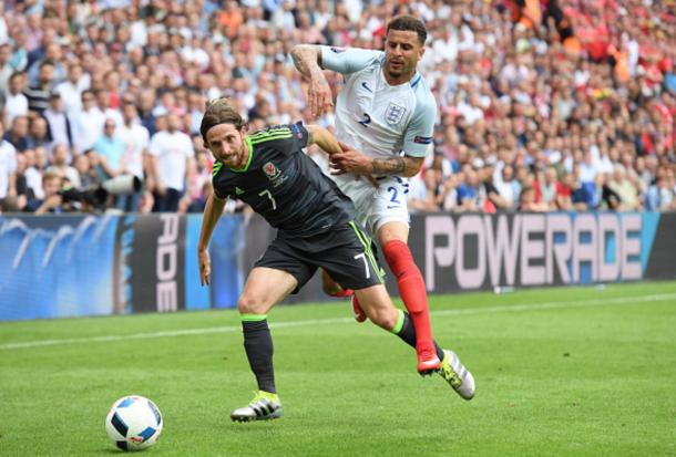 Joe Allen battles with Tottenham's Kyle Walker on Thursday. (Picture: Getty Images)