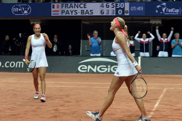 rance's Caroline Garcia (L) and Kristina Mladenovic celebrate after France won the Fed Cup semi-final double tennis match against the Netherlands in Trelaze, northwestern France, on April 17, 2016. / AFP / JEAN-FRANCOIS MONIER