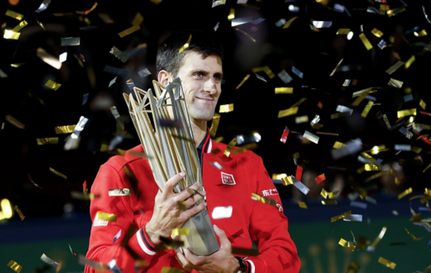 Novak Djokovic of Serbia poses with the winner's trophy after defeating Jo-Wilfried Tsonga of France during the men's singles final match of the Shanghai Rolex Masters at the Qi Zhong Tennis Center on day 8 of Shanghai Rolex Masters at Qi Zhong Tennis Centre on October 18, 2015 in Shanghai, China. (Photo by Lintao Zhang/Getty Images)