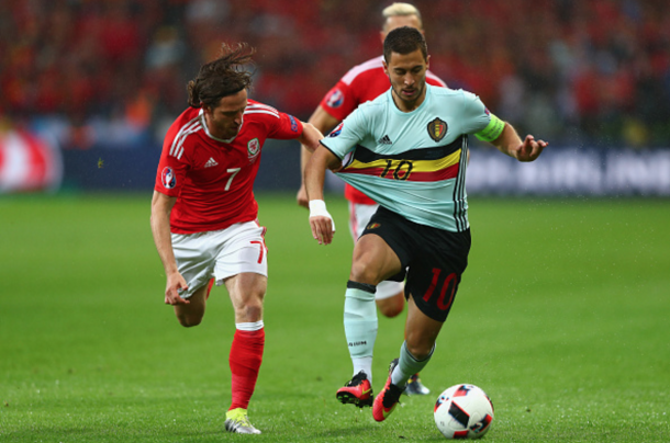 Allen chases Chelsea's Eden Hazard in their historic victory over Belgium. (Picture: Getty Images)
