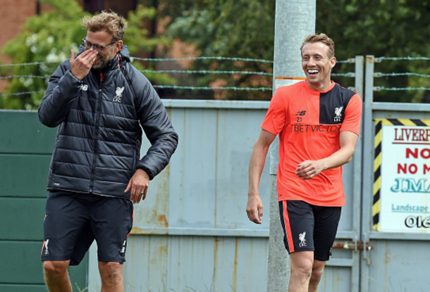 Klopp and Lucas share a laugh in pre-season training at Melwood last week. (Picture: Getty Images)