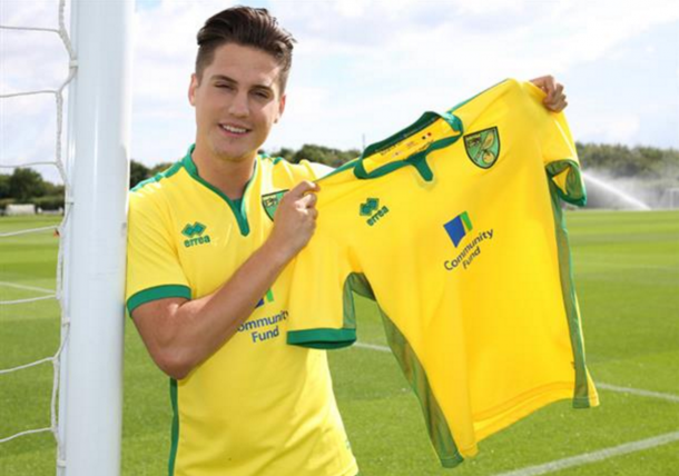 Canos pictured with a Norwich shirt shortly after confirming his move to the club. (Picture: Getty Images)