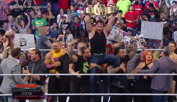 Dean Ambrose celebrates with the SmackDown Locker room (image: WWE NETWORK)